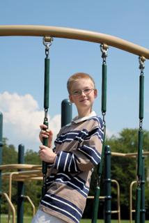 autistic boy in playground